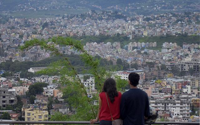 A couple enjoying the view of Kathmandu from the premises of Swoyambhunath stupa on Saturday. Photo: THT