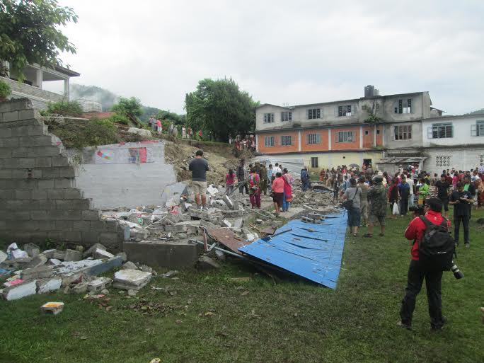 A wall of the Ex-Army Boarding School in Chorepatan that collapsed due to heavy rainfall in Pokhara on Thursday, June 16, 2015. Photo: Rishi Ram Baral