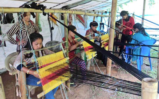 Women weaving dhaka cloth in Diktel, Khotang, on Tuesday. Photo: THT