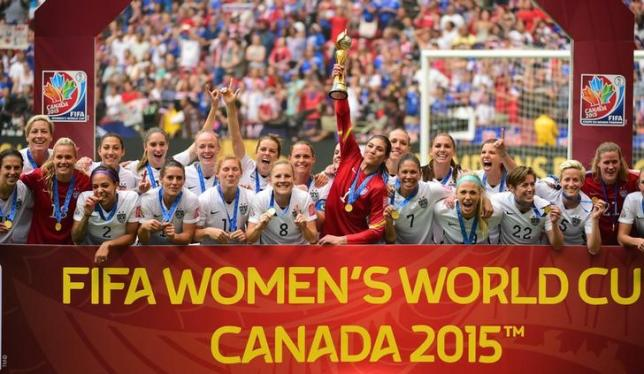 Jul 5, 2015; Vancouver, British Columbia, CAN; United States goalkeeper Hope Solo (1) hoists the FIFA Women's World Cup trophy as she and her teammates pose with their medals after defeating Japan in the final of the FIFA 2015 Women's World Cup at BC Place Stadium. Credit: Anne-Marie Sorvin-USA TODAY Sports