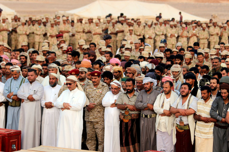 Yemeni army officers and troops perform prayers during the funeral procession of troops killed by Saudi-led air strike on an army base that was hit in error, in al-Abr on the border with Saudi Arabia July 11, 2015. Dozens of soldiers were reportedly killed in a Saudi-led air strike on July 7 on the base of soldiers loyal to the exiled President Abdu-Rabbu Mansour Hadi, local media said. Photo: Reuters