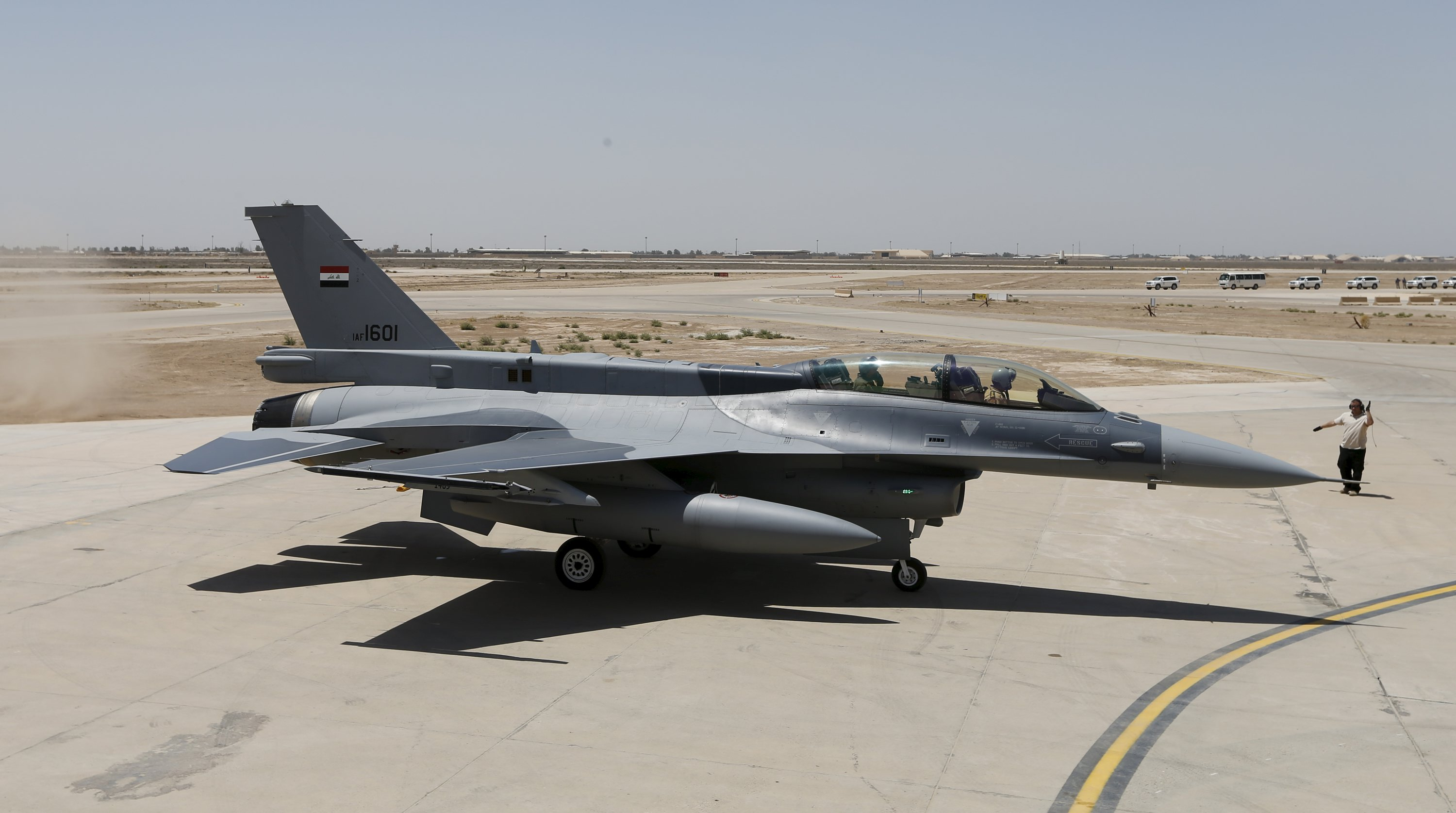 Iraq's Defence Minister Khaled al-Obeidi (left) sits in a F-16 fighter jet, during an official ceremony to receive four of these aircrafts from the US at a military base in Balad, Iraq, July 20, 2015. Photo: Reuters