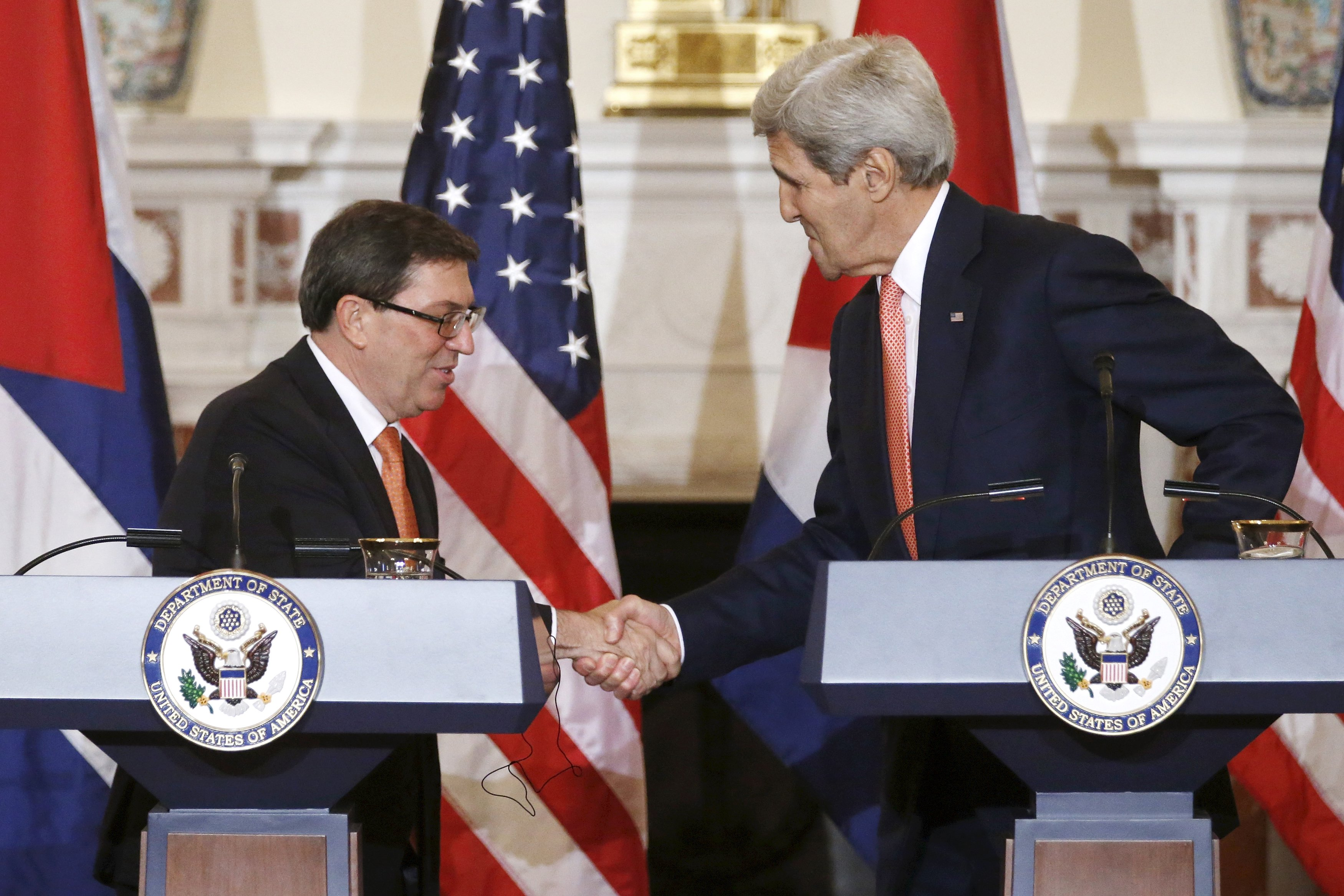 Cuba's Foreign Minister Bruno Eduardo Rodriguez Parilla (left) and US Secretary of State John Kerry shake hands during a news conference at the State Department in Washington on July 20, 2015. The Cuban flag was raised over Havana's embassy in Washington on Monday for the first time in 54 years as the United States and Cuba formally restored relations, opening a new chapter of engagement between the former Cold War foes.  Photo: Reuters