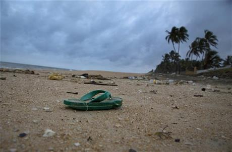 In this Aug. 13, 2015 photo, a sandal lies among other debris washed ashore on the Indian Ocean beach in Uswetakeiyawa, north of Colombo, Sri Lanka. For years along the Cornish coast of Britain, Atlantic Ocean currents have carried thousands of Lego pieces onto the beaches. In Kenya, cheap flip-flop sandals are churned relentlessly in the Indian Ocean surf, until finally being spit out onto the sand. In Bangladesh, fishermen are haunted by floating corpses that the Bay of Bengal sometimes puts in their path. And now, perhaps, the oceans have revealed something else: parts of Malaysian Airlines Flight 370, the jetliner that vanished 17 months ago with 239 people on board. Photo:AP