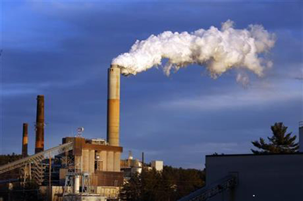 In this Jan. 20, 2015 file photo, a plume of steam billows from the coal-fired Merrimack Station in Bow, N.H. President Barack Obama on Monday, Aug. 3, 2015, will unveil the final version of his unprecedented regulations clamping down on carbon dioxide emissions from existing U.S. power plants. The Obama administration first proposed the rule last year. Opponents plan to sue immediately to stop the rule's implementation. Photo:AP