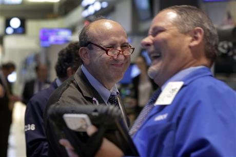 Andrew Silverman, left, and a fellow trader work on the floor of the New York Stock Exchange, Thursday, Aug. 27, 2015. U.S. stocks closed sharply higher after China's main stock index logged its biggest gain in eight weeks. AP