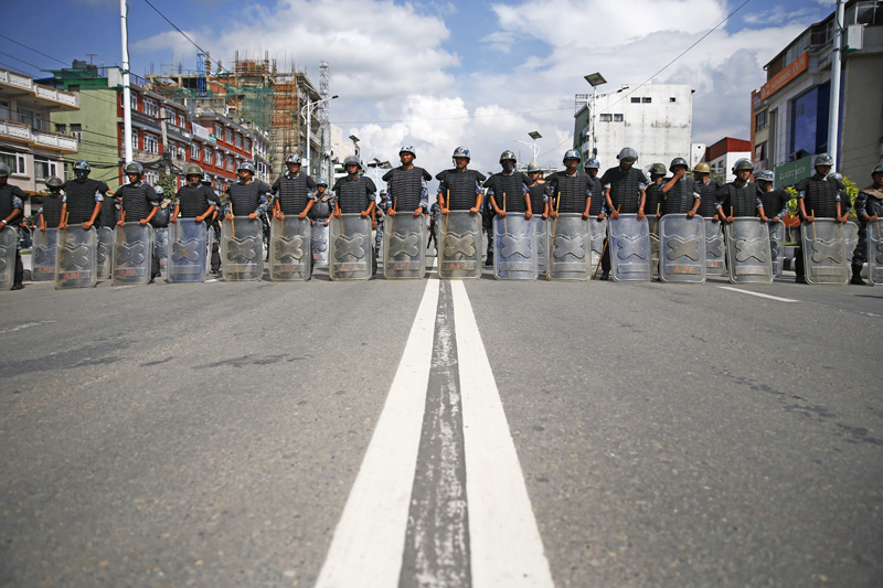 Armed Police Force personnel standing in formation to bar those protesting against the draft constitution from entering restricted area in New Baneshwor, Kathmandu, on Friday. Photo:THT