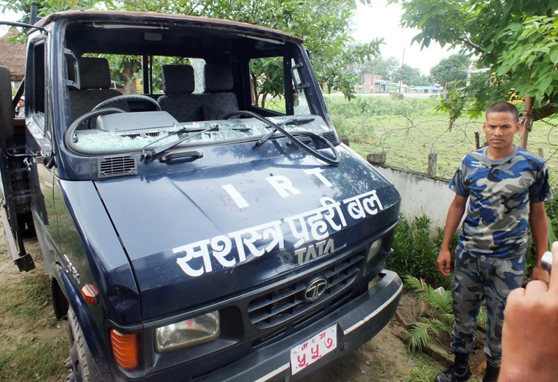An Armed Police Force van that was vandalised by anti-charter protesters at Bhardaha, in Saptari, on Tuesday. Photo: THT