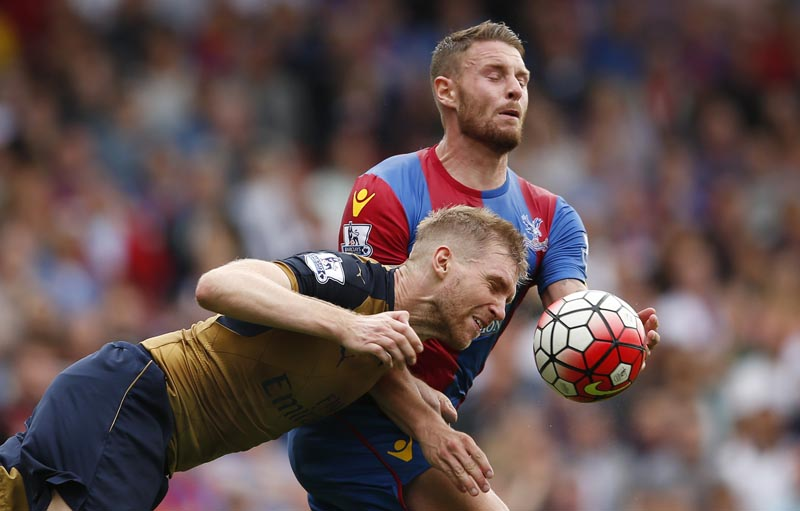 Arsenal's Per Mertesacker in action with Crystal Palace's Connor Wickham. Photo: Reutersnn