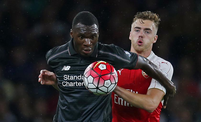 Liverpool's Christian Benteke in action with Arsenal's Calum Chambers. Photo: Reuters