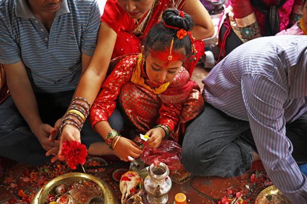 A child performing traditional rituals during Bel Bibah in Basantapur Durbar Square, Kathmandu, on Friday. Photo:THT
