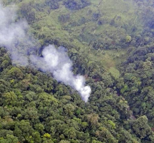 Handout picture from the Colombian Police shows smoke billowing from the site where a Blackhawk helicopter went down, killing 15 officers during an operation in Carepa, Antioquia department, Colombia on August 4, 2015.