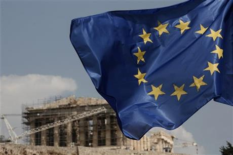 A European Union (EU) flag flutters in front of the temple of the Parthenon in Athens, Greece, Saturday, Aug. 15, 2015. AP