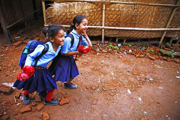 School children holding flowers for their teachers during Guru Purnima, which is a festival dedicated to spiritual and academic teachers in Durbar High School, Ranipokhari, Kathmandu on Friday. PHOTO: THT