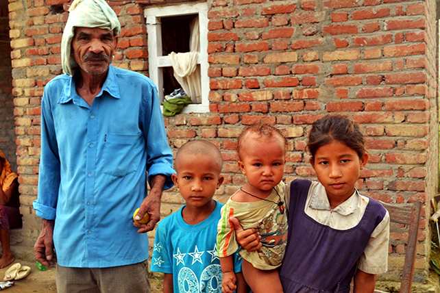 Family of police constable Janak Negi. His father 60 year old BirSingh Negi is seen along with his children. Negi passed away while undergoing treatment in the Tikapur incident. His childrenu2019s future is in a dilemma after he passed away.