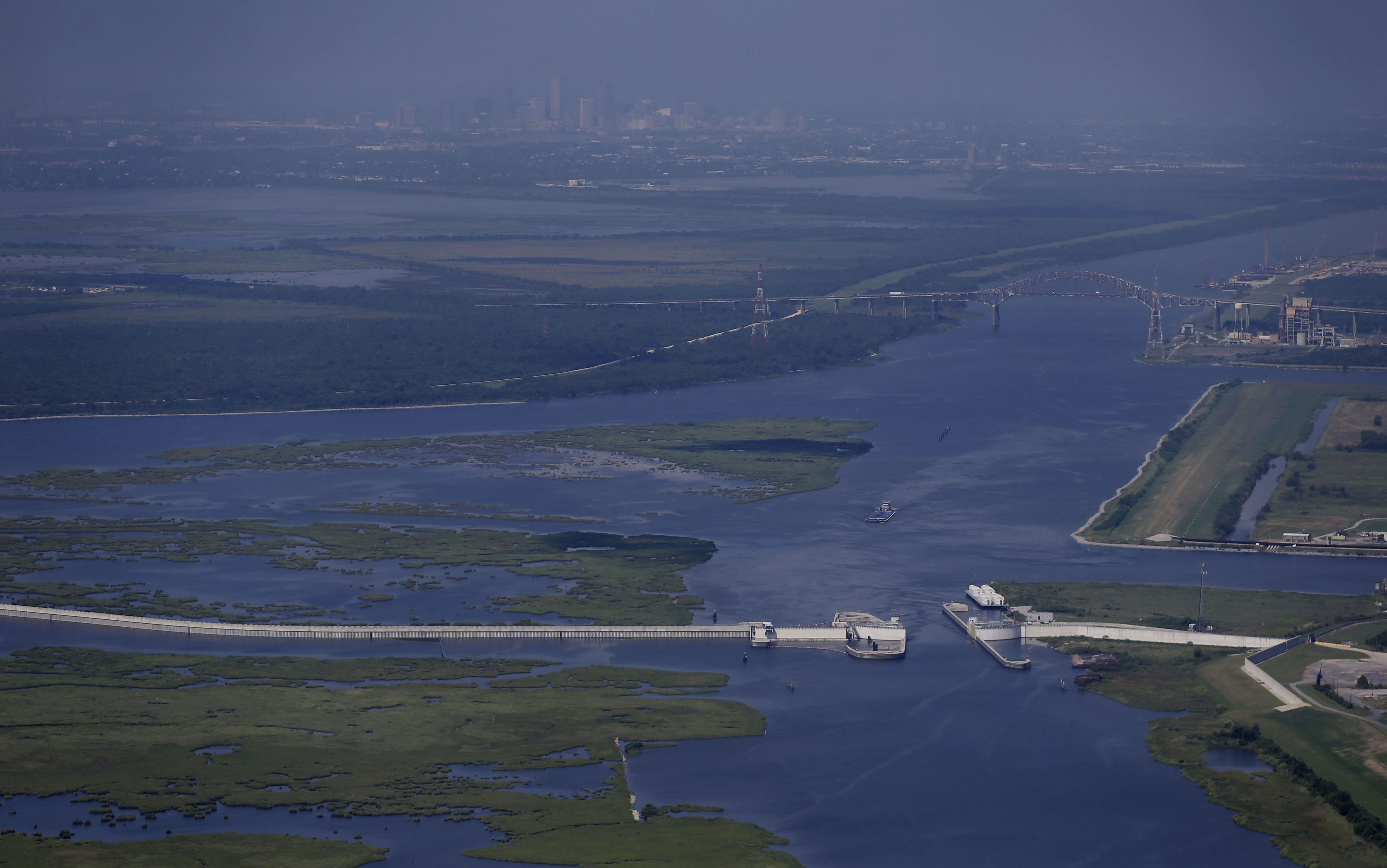 This aerial photo made during a flight provided by the National Wildlife Federation and Southern Wings shows the Lake Borne storm surge barrier in St. Bernard Parish, Louisiana, on Monday, Aug. 10, 2015, which was built after Hurricane Katrina, with the skyline of New Orleans in the background. Scientists say Katrina was especially destructive because of the disappearance of buffer land between New Orleans and the Gulf. Photo: AP