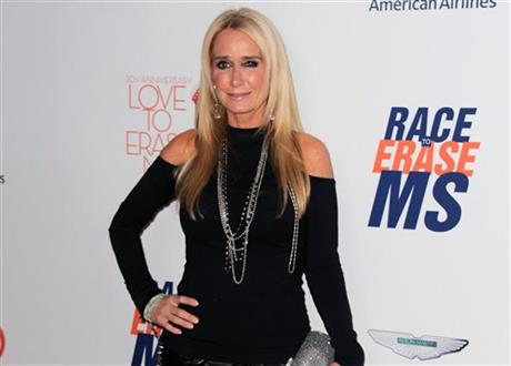 FILE - In this May 3, 2013 file photo, Kim Richards arrives at the 20th annual Race to Erase MS event in Los Angeles. Richards is out on bail after she was arrested on suspicion of shoplifting in Los Angeles.AP