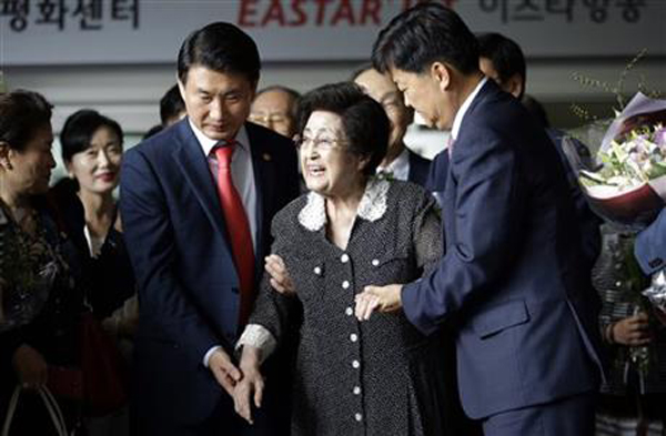 Lee Hee-ho, the widow of former South Korean President and Nobel Peace Prize laureate Kim Dae-jung, is escorted after speaking to the media at Gimpo International Airport in Seoul, South Korea, Saturday, Aug. 8, 2015, after returning from North Korea. Lee returned to Seoul after a four-day visit to North Korea that apparently ended without a meeting with North Korean leader Kim Jong Un. Lee told reporters that she wasnu0092t carrying any official duty on behalf of South Korea during her trip. Photo:AP