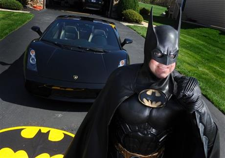 In this March 27, 2012, photo, Leonard Robinson, dressed as Batman, poses for a photo outside his home, in Owings Mills, Md. Authorities say, Robinson, known for visiting hospitalized children dressed in his Batman costume, died, Sunday, Aug. 16, 2015, in a crash on Interstate 70, in western Maryland. AP
