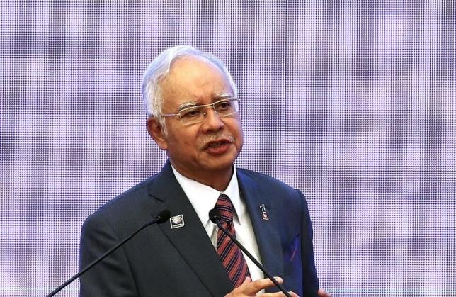 Malaysia's Prime Minister Najib Razak speaks at the 48th Association of Southeast Asian Nations (ASEAN) foreign ministers meeting in Kuala Lumpur, Malaysia, August 4, 2015. REUTERS/Olivia Harris