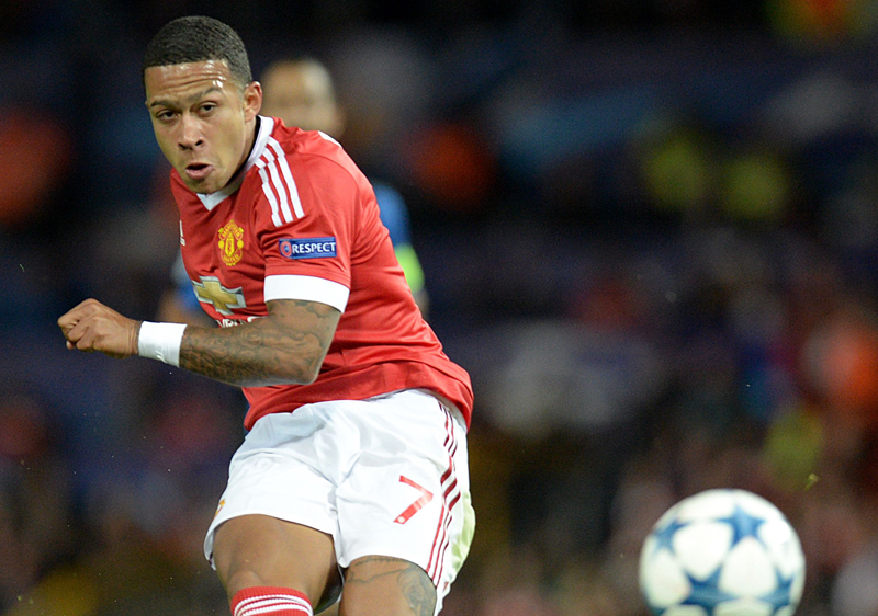 Manchester United's Memphis Depay shoots the ball against Club Brugge during their UEFA Champions League play-off match at Old Trafford, on Tuesday. Photo:AFP