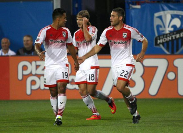 Aug 8, 2015; Montreal, Quebec, CAN; D.C. United forward Chris Rolfe (18) celebrates his goal against Montreal Impact with teammates forward Jairo Arrieta (19) and defender Chris Korb (22) during the first half at Stade Saputo. Photo:REUTERS