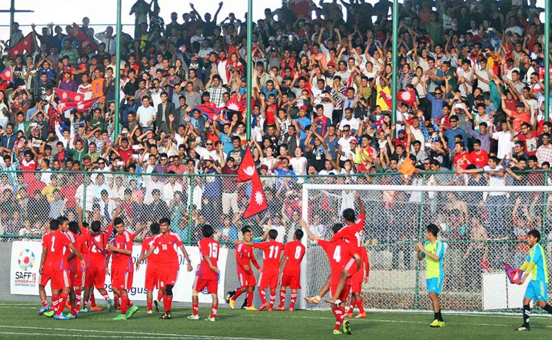 The Nepal Under-19 football players acknowledge the crowd  as they celebrate their victory over India in the final of the first SAFF U-19 Championship at the ANFA Complex grounds in Lalitpur on Saturday. Nepal defeated nIndia 5-4 in penalty shoot-out to win the first major title in more than two decades.nPhoto: Udipt Singh Chhetry /THT