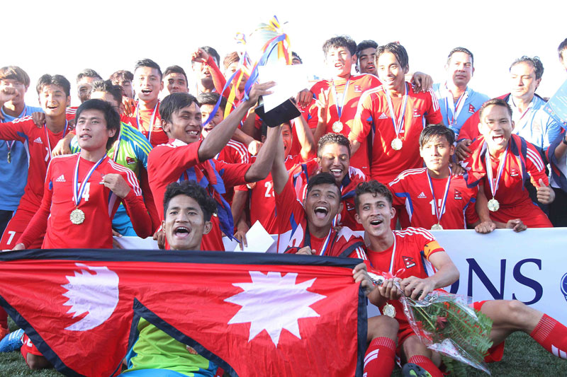 Players and officials of national U-19 team take group photo with winner's trophy after the prize distribution ceremony of the 1st SAFF U-19 Championship at ANFA Complex in Lalitpur on Saturday. Photo: Udipt Singh Chhetry