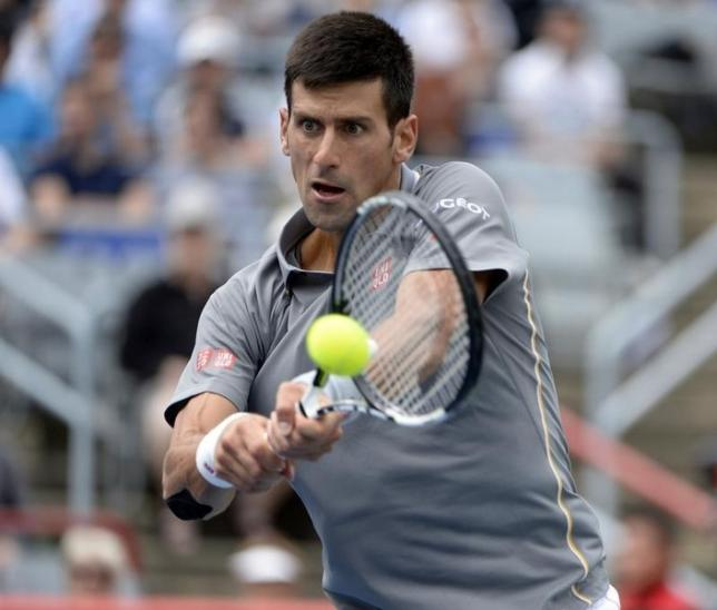 Aug 13, 2015; Montreal, Quebec, Canada; Novak Djokovic of Serbia hits the ball against Jack Sock of the United States (not pictured) during the Rogers Cup tennis tournament at Uniprix Stadium.  Eric Bolte-USA TODAY Sports