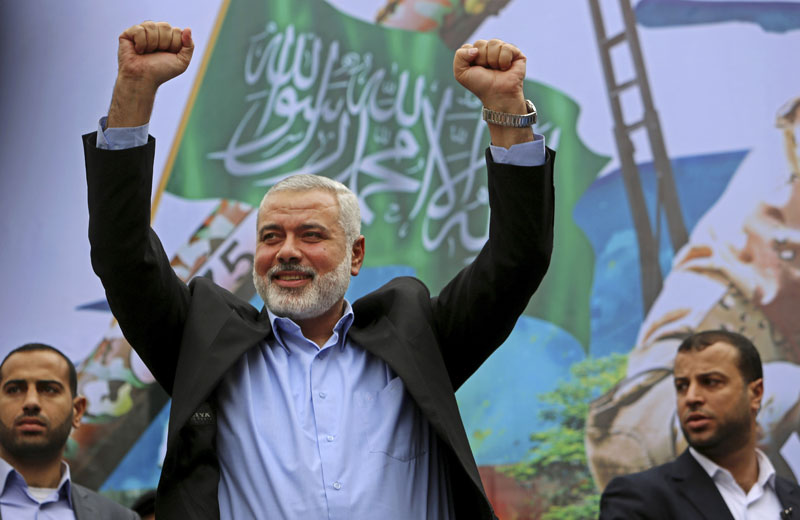 In this Friday, Dec. 12, 2014 file photo, Palestinian top Hamas leader Ismail Haniyeh greets supporters during a rally to commemorate the 27th anniversary of the Hamas militant group, at the main road in Jebaliya in the northern Gaza Strip. Photo: AP
