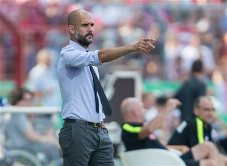 Munich's coach Pep Guardiola gestures during the German soccer cup first round match between fifth tier team FC Noettingen and Bayern Munich in Karlsruhe, southern Germany, Sunday, Aug. 9, 2015.  AP