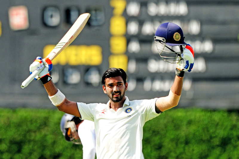 Indiau0092s Lokesh Rahul raises his bat and helmet in celebration after scoring a century against Sri Lanka on the first day of their second Test match at the P Sara Oval Cricket Stadium in Colombo on Thursday. Photo: AFP