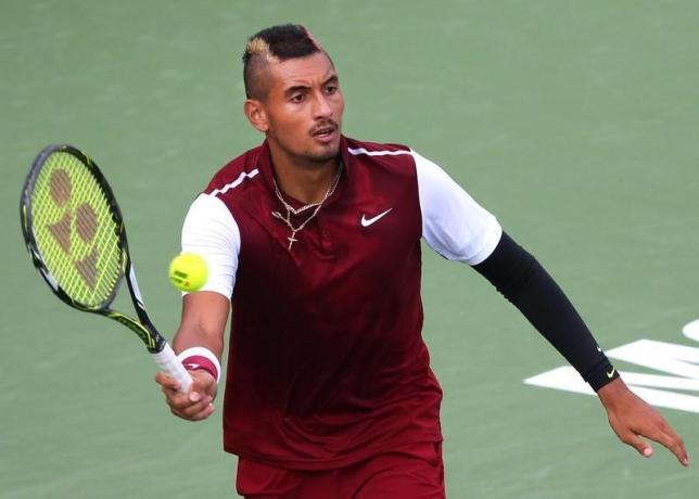 Aug 13, 2015; Montreal, Quebec, Canada; Nick Kyrgios of Australia hits a shot against John Isner of the United States (not pictured) during the Rogers Cup tennis tournament at Uniprix Stadium. Jean-Yves Ahern-USA TODAY Sports