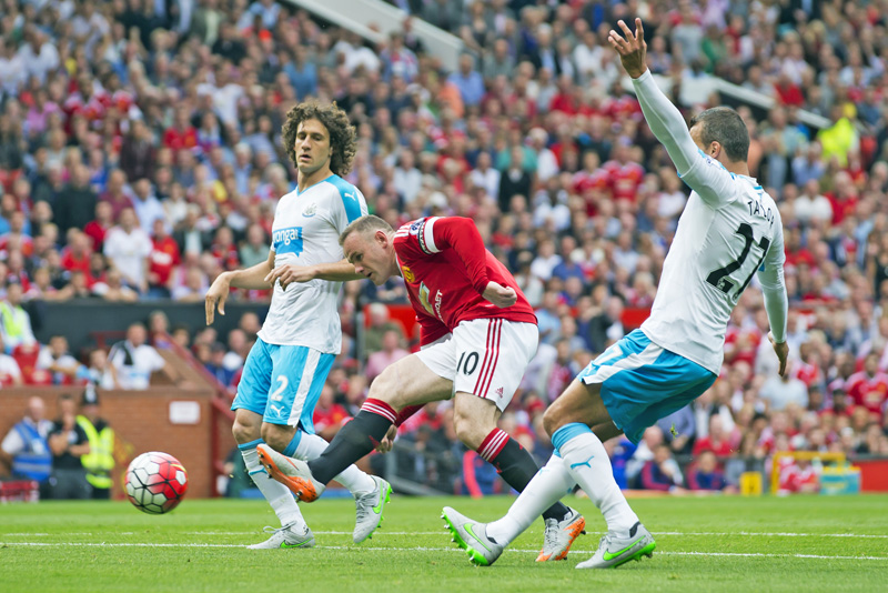 Manchester United's Wayne Rooney (centre) shoots the ball during the English Premier League match against Newcastle at the Old Trafford Stadium in Manchester on Saturday. Photo: AP