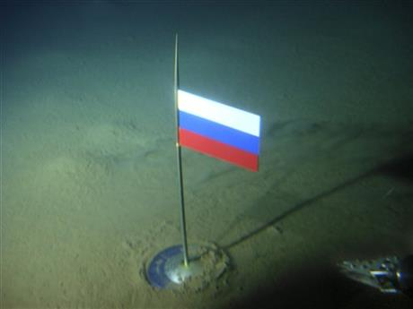 FILE - In this Thursday, Aug. 2, 2007 file made available by the Association of Russian Polar Explorers on Wednesday, Aug. 8, 2007, photo a titanium capsule with the Russian flag is seen seconds after it was planted by the Mir-1 mini submarine on the Arctic Ocean seabed under the North Pole during a record dive.AP