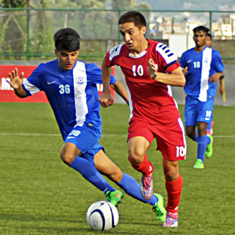 Afghanistan player (right) dribbles the ball past an Indian player during their first SAFF U-19 Championship match at the ANFA Complex in Lalitpur on Sunday. Photo: Naresh Shrestha/ THT