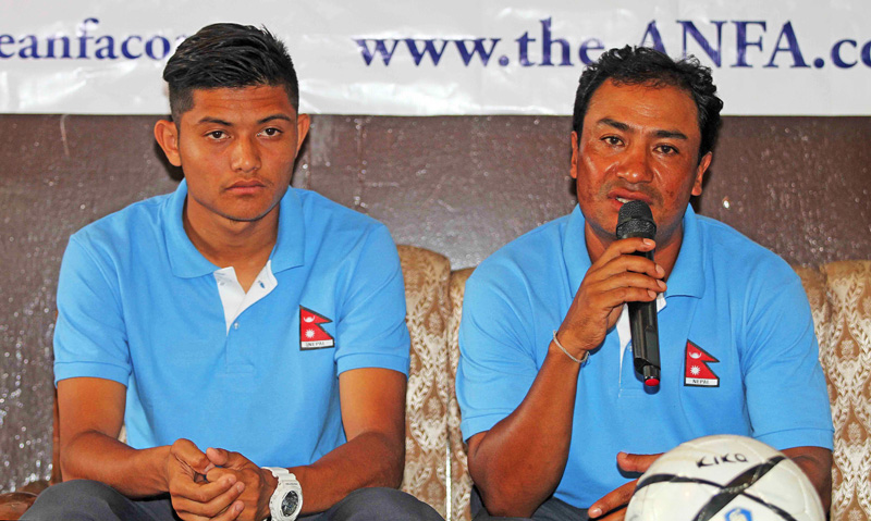 Coach Bal Gopal Maharjan (right) talking with media as U-19 skipper Bimal Gharti Magar looks on during the pre-match press conference at ANFA Complex in Lalitpur on Wednesday. Photo:THT