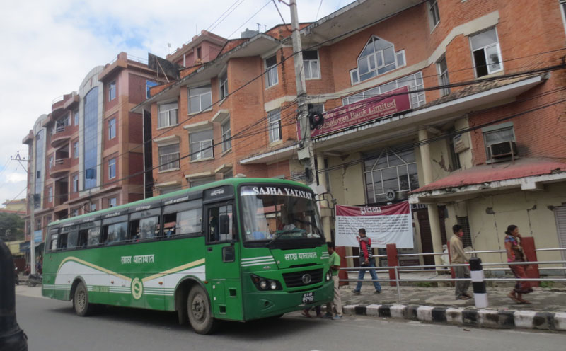 A Sajha Yatayat is seen plying on the road during the general strike called by the Nepal Federation of Indigenous Nationalities (NEFIN) in the Capital on Sunday, August 23, 2015. THT Online