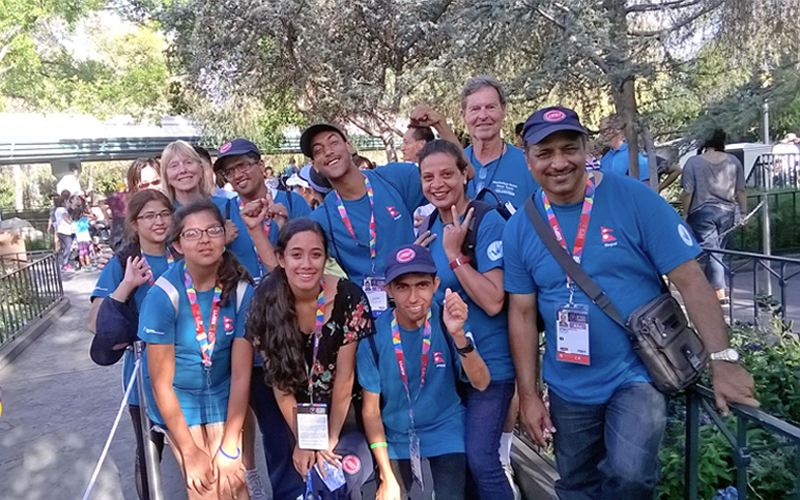 Nepali players and officials, participants of the Special Olympics World Games, enjoying a moment at Disneyland Park on Friday. Photo: THT