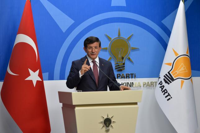 Turkey's Prime Minister Ahmet Davutoglu speaks during a news conference at his ruling AK Party (AKP) headquarters in Ankara, Turkey, August 13, 2015. REUTERS/Stringer