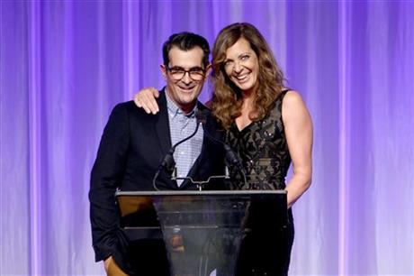 Ty Burrell, left, and Allison Janney accept grants on behalf of the Toronto Film Festival, the Los Angeles Conservancy, Museum Movings and the Library Foundation at The Hollywood Foreign Press Association's Annual Grants Banquet at the Beverly Wilshire hotel on Thursday, Aug. 13, 2015, in Beverly Hills, Calif. AP