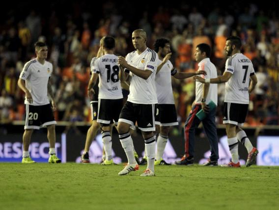 Valencia's players celebrate their victory over Monaco after their Champions League play-off first leg soccer match at the Mestalla stadium in Valencia, Spain, August 19, 2015. REUTERS/Heino Kalis