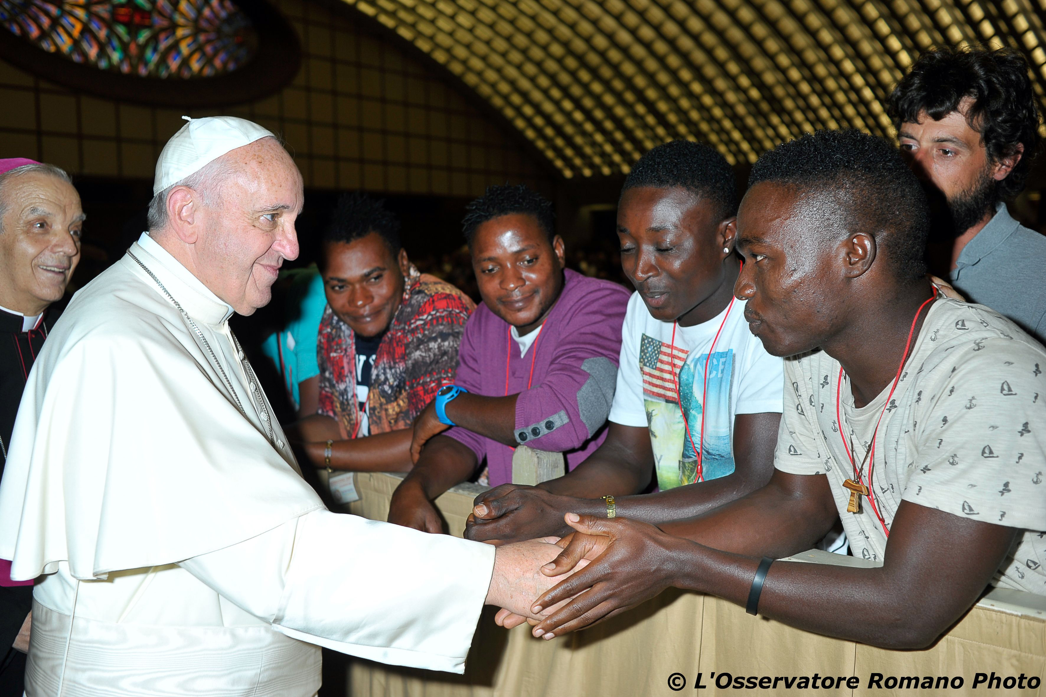 Pope Francis salutes migrants from Nigeria during his weekly general audience he held in the Pope Paul VI hall, at the Vatican,  on Wednesday, Aug. 12, 2015. Photo: L'Osservatore Romano/ AP