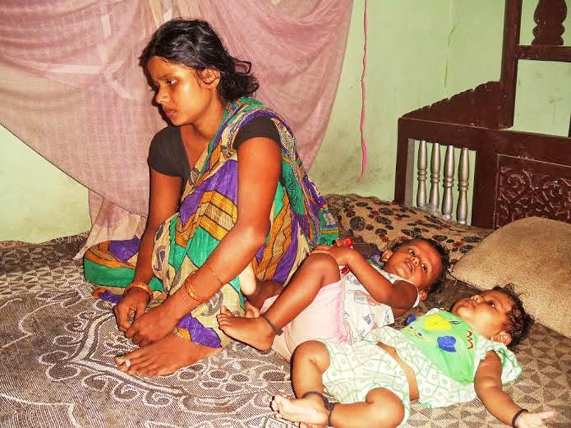Widow of Rajendra Kumar Raut (Rajiv) with her two children at her home in Bhardaha of Saptari on Sunday, August 23, 2015.  Her husband had died in a clash with police on last Tuesday. Photo: Byas Shankar Upadhayaya