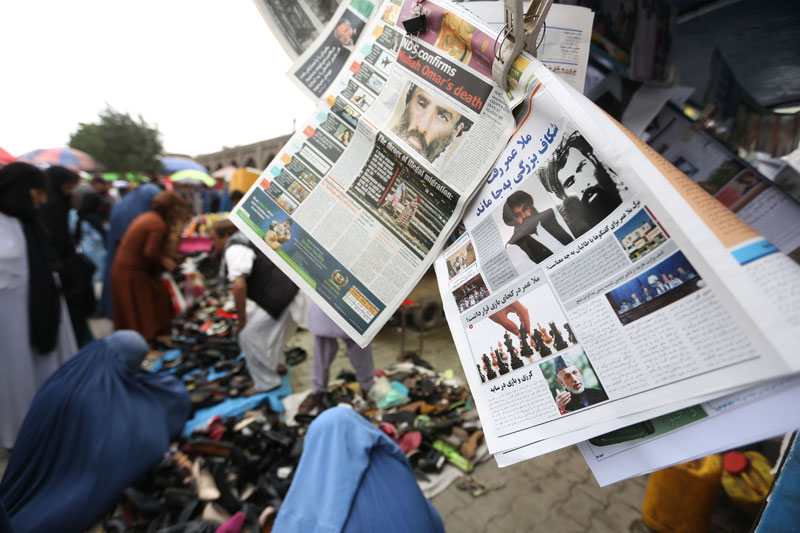 Newspapers hang for sale at a stand carrying headlines about the new leader of the Afghan Taliban, Mullah Akhtar Mohammad Mansoor, in Kabul, Afghanistan, Saturday, Aug. 1, 2015. Photo: AP