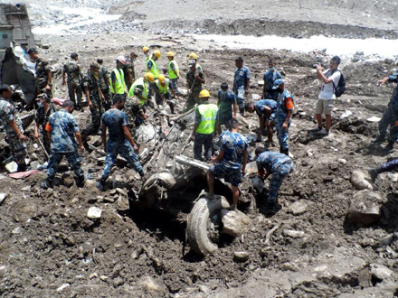 Security personnel extracting the remains of a vehicle buried in a landslide while constructing the road on Araniko Highway at Jureu201a in Mankha VDC of Sindhupalchoku201a in August 2014. Photo: THT/File n