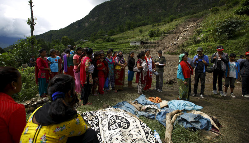 People gather around the bodies retrieved from the landslide at Lumle village in Kaski district July 30, 2015. Photo: Reuters