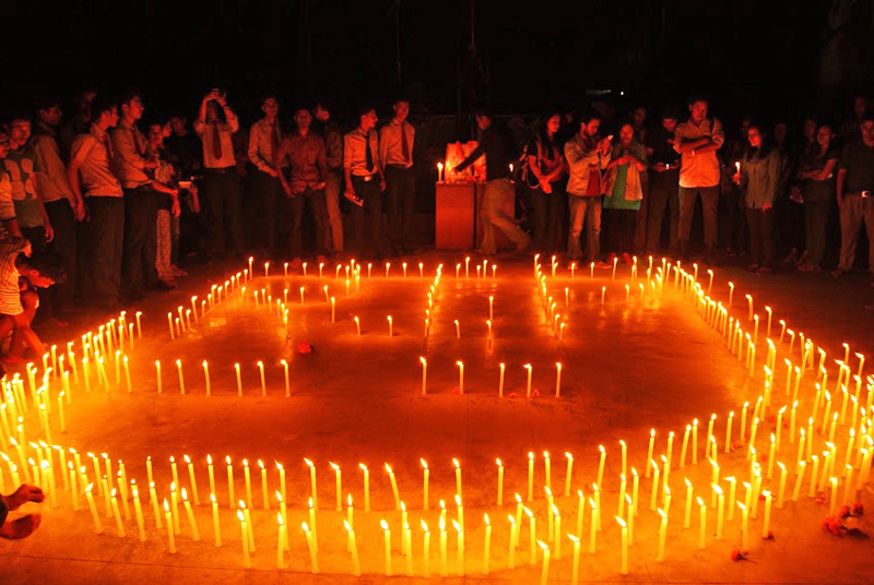 With a candle light vigil, students paying tribute to late SSP Laxman Neupane and other security personnel killed in Tikapur, Kailali, in Kathmandu, on Friday.Approximately 500 students,staff and teachers of Golden Gate International College assembled to pay homage to the departed souls. Photo:THT