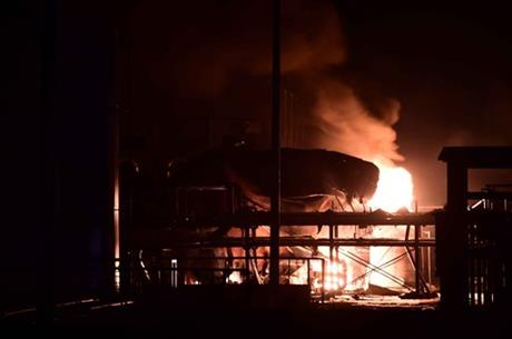 In this photo released by China's Xinhua News Agency, a chemical plant of Shandong Runxing Chemical Technology Co. is on fire following an explosion in Zibo, east China's Shandong Province, Sunday, Aug. 23, 2015. AP