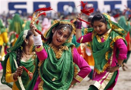 School girls, dressed in traditional attire, perform on the occasion of 69th anniversary of India's independence from British rule, in Jammu, India, Saturday, Aug. 15, 2015. AP
